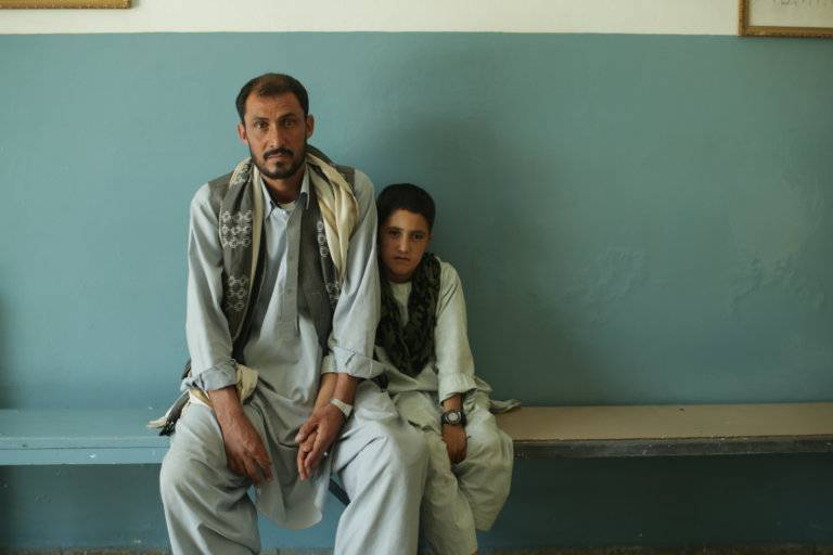 "An Afghan survivor of a U.S. drone air strike with his son in ""National Bird."