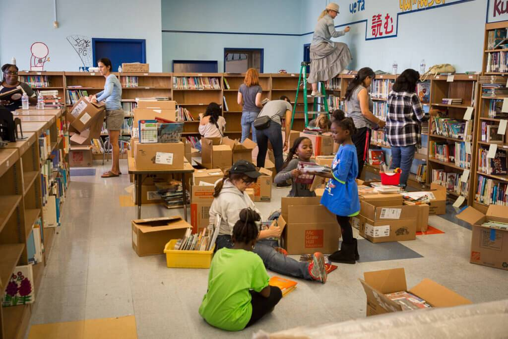 Volunteers and Access Books crew at work at the Washington Elementary library.