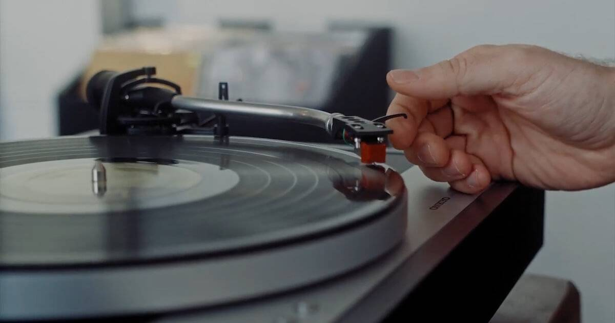 A hand dropping the needle on a record player Vinyl Collection pbs rewire