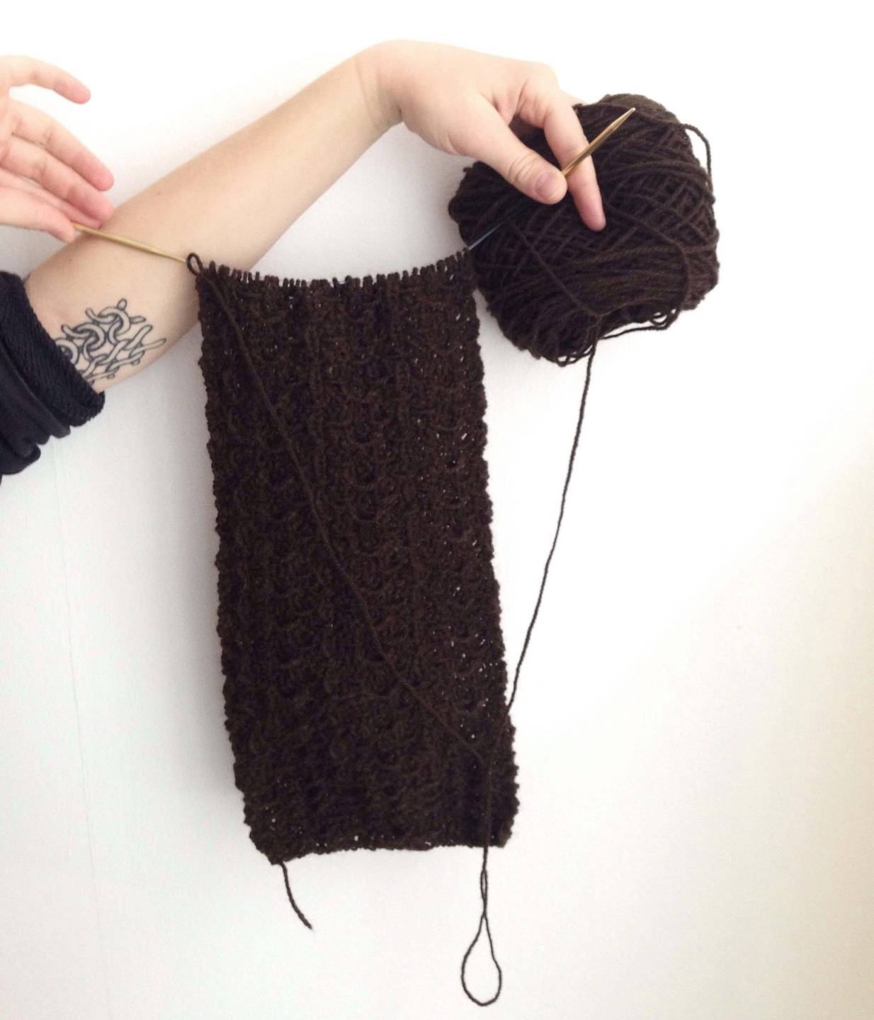 A knitted scarf being displayed Sustainable Wardrobe pbs rewire