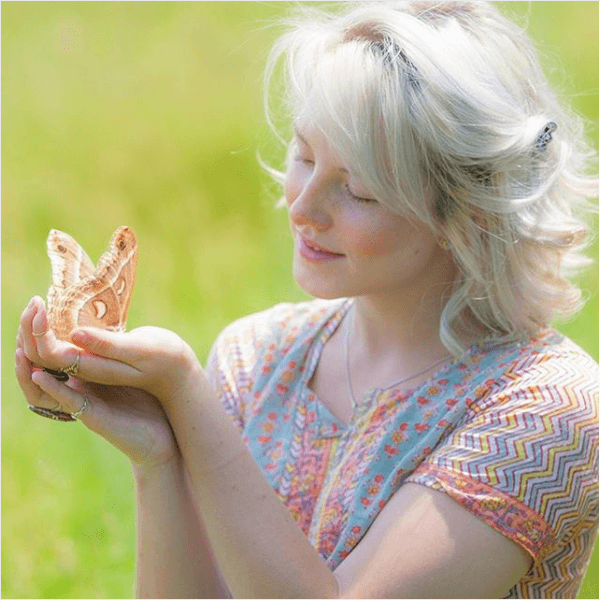 Woman holding butterfly in her hand. Rewire PBS Our Future Pollinators