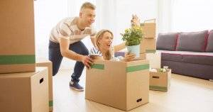 Couple having fun while moving into new apartment Stress Less pbs rewire