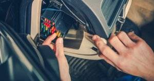 Person replacing car fuses Car Care pbs rewire