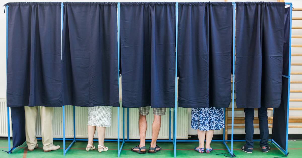 People in voting booths pbs rewire