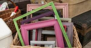 Differed colored painted wood frames in a basket for sale. Decorate Sustainably pbs rewire