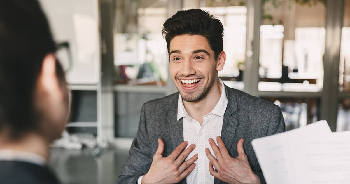 Business, career and placement concept - surprised caucasian man 30s rejoicing and showing at himself when hiring during job interview with employees in office. Rewire PBS Work Resume Stand Out