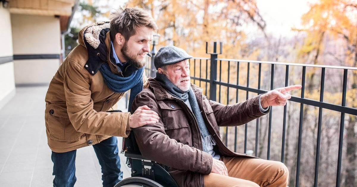 Father in wheelchair and young son on a walk. Aging Loved Ones pbs rewire