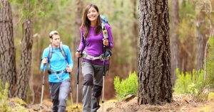 Couple hiking in fall forest. National Forests pbs rewire