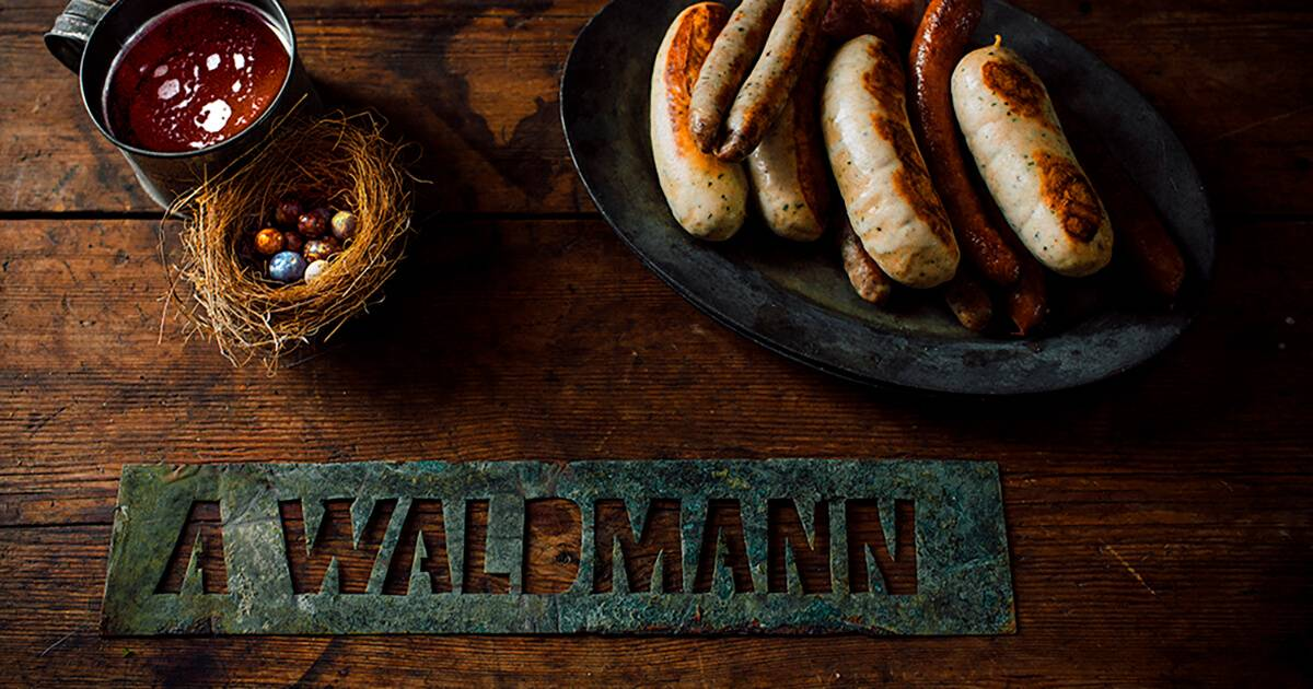 A photo of Waldmann Brewery's handmade sausages, beer, a nest full of antique marbles, and the original metal stencil found on the premises. Rewire Living PBS Waldmann