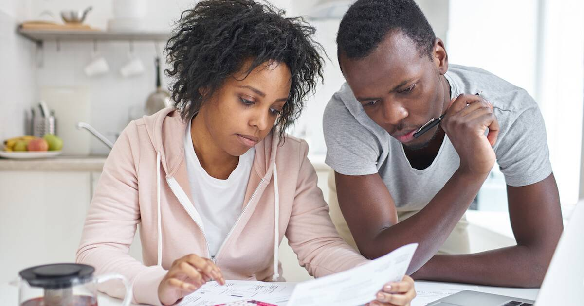 African-American couple discussing finances. Financial Procrastination pbs rewire