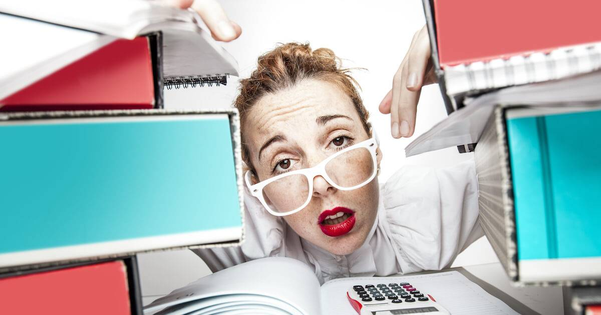 Woman with stacks of work on her desk. Stop Stress pbs rewire