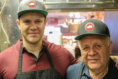 Father and son pose for a photograph in their restaurant in Chicago. Rewire PBS Mexican