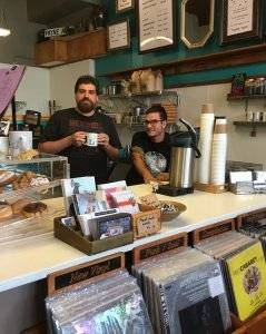 The founders of Caydence Records & Coffee behind the counter. pbs rewire