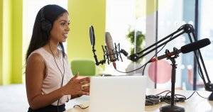 Young woman recording a podcast. Patreon pbs rewire