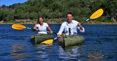 A young couple kayaking on a lake. FOMO pbs rewire