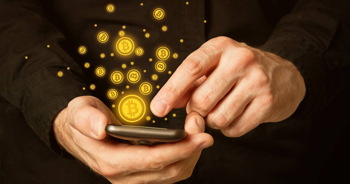 Man holding smartphone with bitcoins coming out of it. Bitcoin pbs rewire