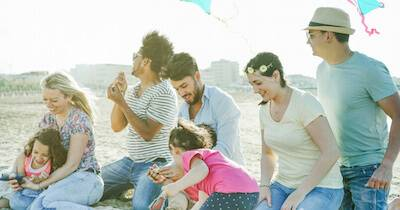 Group of friends enjoying the beach and flying kites with their friend's kids. Friend Becomes a Parent pbs rewire