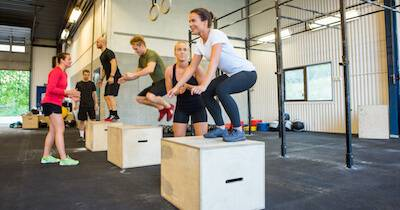 Many different people jumping onto large boxes at a gym. Postpone Your Commute pbs rewire