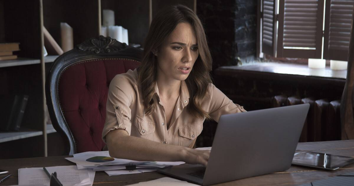 Businesswoman stressed out while looking at her laptop. Work Addiction pbs rewire