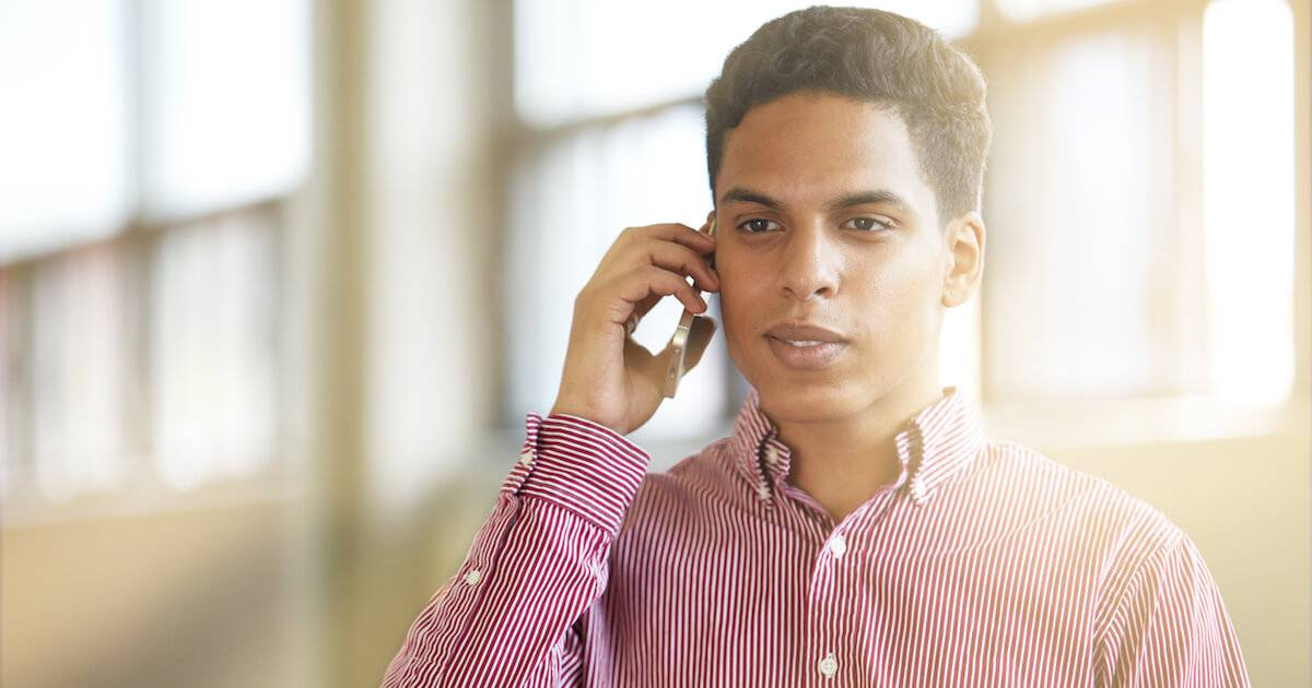 Young African-American man on a phone interview. Getting a Job in Another State pbs rewire