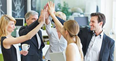Coworkers giving a group high five. Workplace Attire pbs rewire