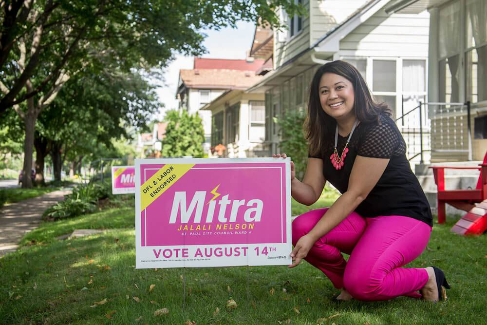 Mitra Jalali Nelson poses with one of her pink signs in St. Paul, Minnesota. Iranian American Politician pbs rewire