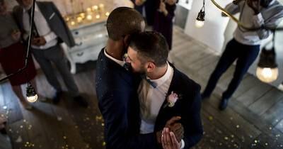 Young gay couple's first dance at their wedding reception. Life Stage Envy pbs rewire