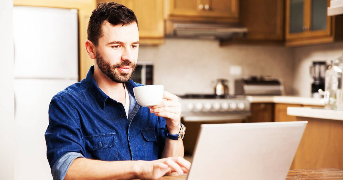 Man sipping coffee as he works from home. Stay Motivated pbs rewire