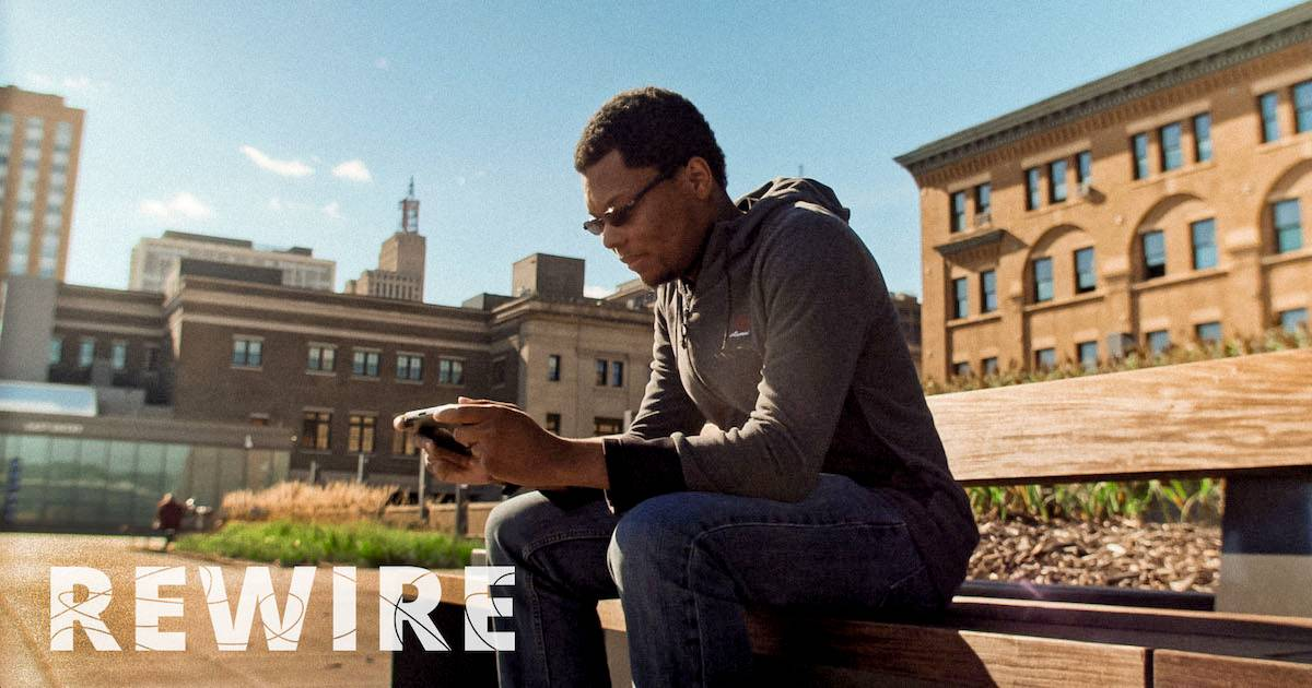 Indie video game designer Charles McGregor working on a laptop in a park. pbs rewire