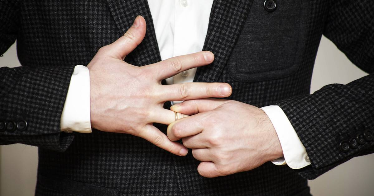 Young man pulling his wedding ring off of his finger. Healthy Divorce pbs rewire