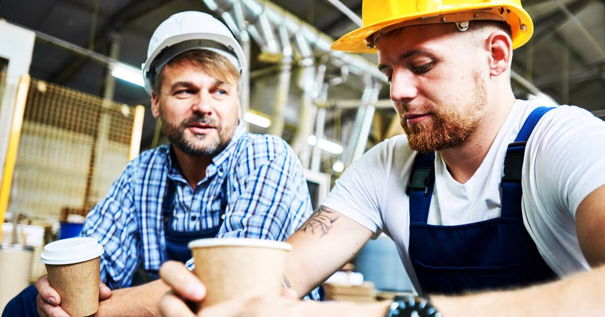 Two male construction workers talking politics at work. pbs rewire