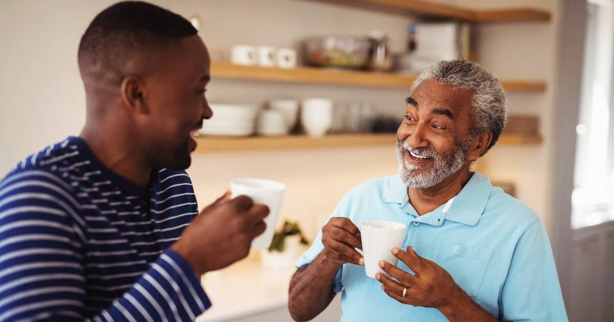 Young black man laughing over coffee with his dad. Friends With Your Parents pbs rewire