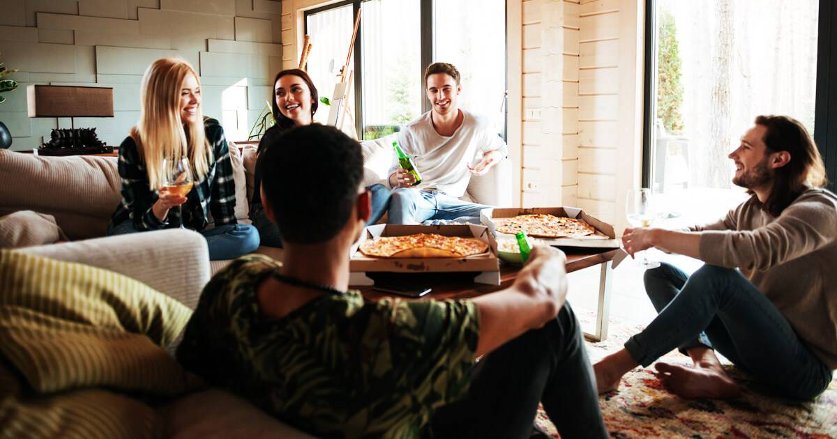 Group of friends talking over some pizza and beers. Chronic Illness pbs rewire