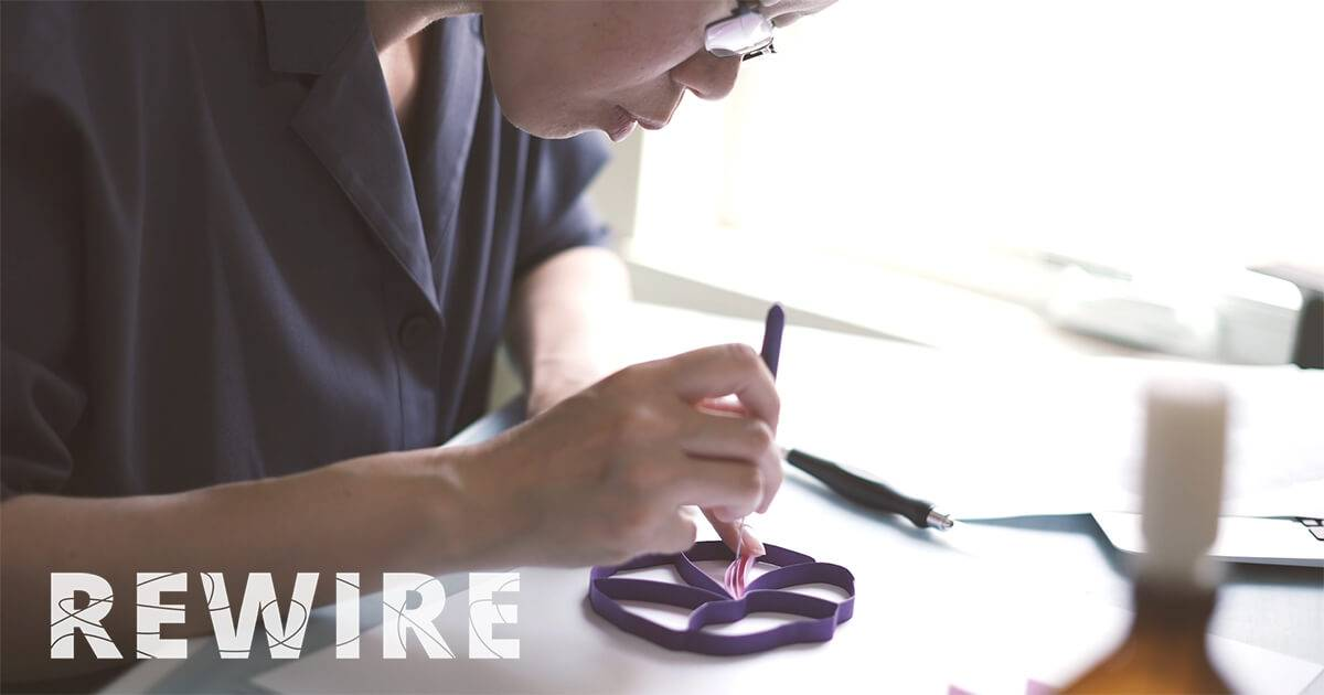 Daphne Lee, of JUDiTH+ROLFE, carefully works on her paper art. pbs rewire