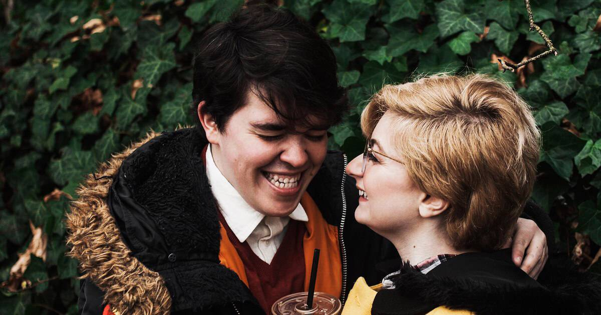 Young LGBTQ couple laughing at each other. Wedding Expectations pbs rewire