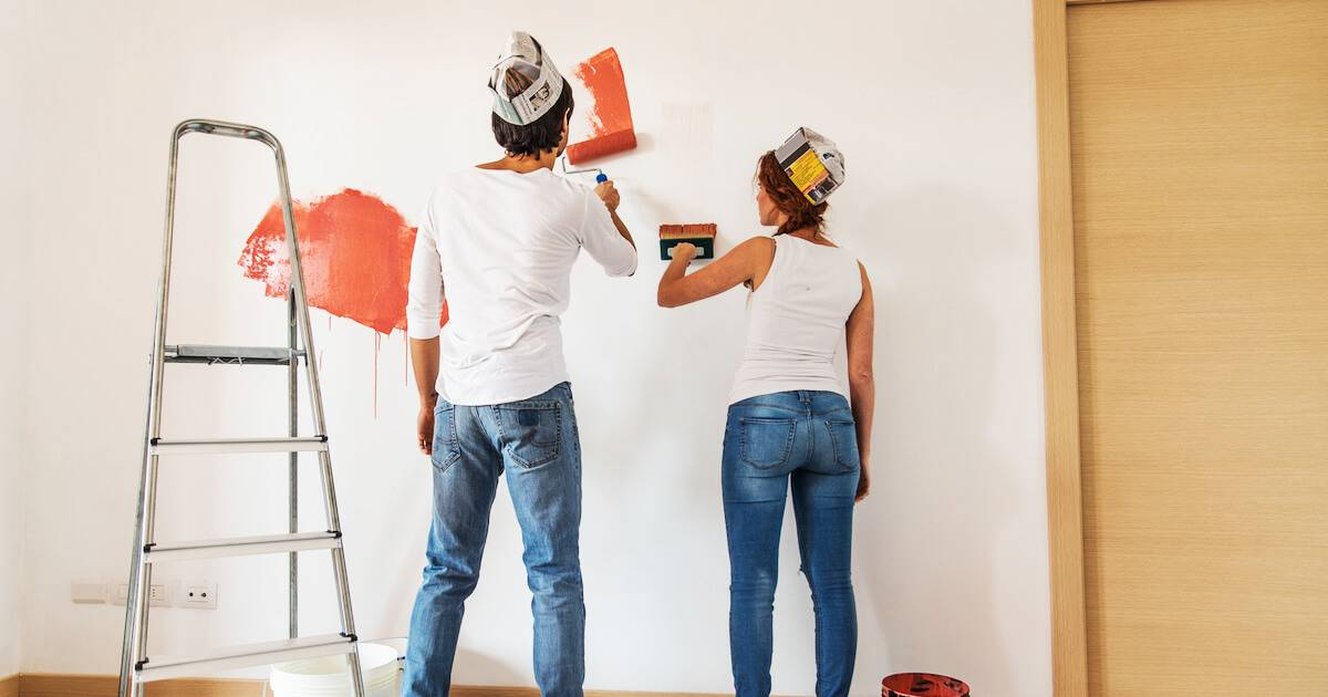 Young couple painting the walls of their first house. pbs rewire
