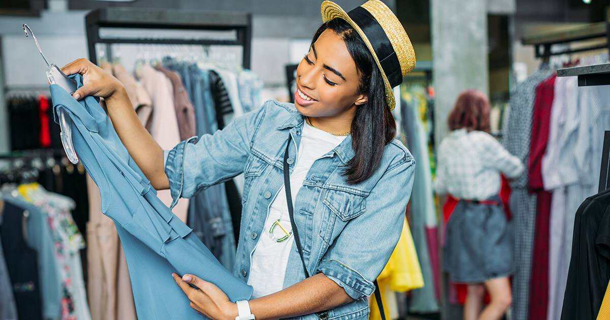 african american hipster girl choosing clothes in shopping mall, boutique shopping concept Rewire PBS Fast Fashion