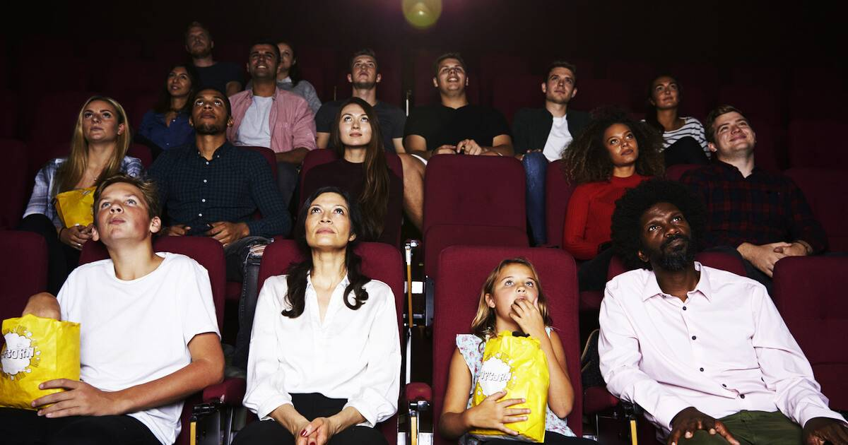 Diverse group of people watching a film in a movie theater. Academy Age Gap pbs rewire