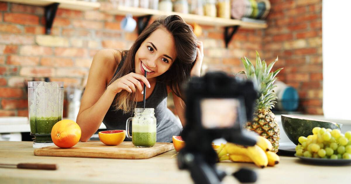 Woman recording a food vlog about juicing. Fake Food Science pbs rewire