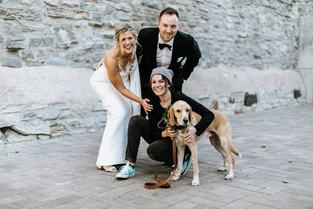 "Lara Leinen, who runs ""wedding pet attendant"" service Doggy Social MN, poses with two of her clients on their wedding day. Dog of Honor pbs rewire"