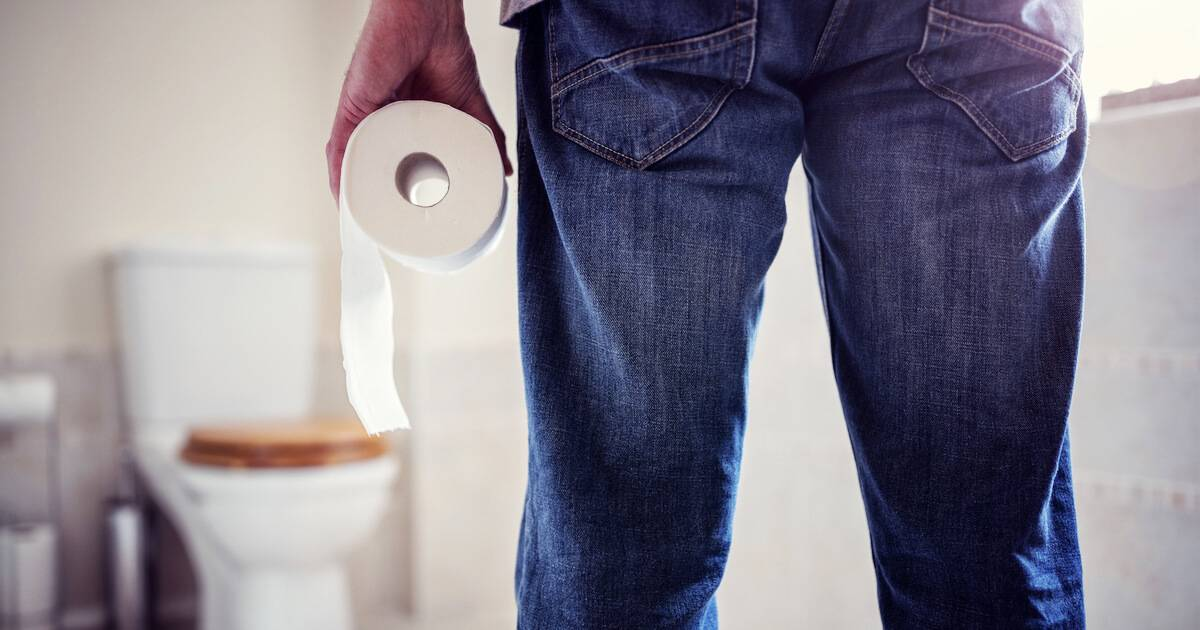 Photo of man holding toilet paper roll looking at toilet. Renewable Resource pbs rewire