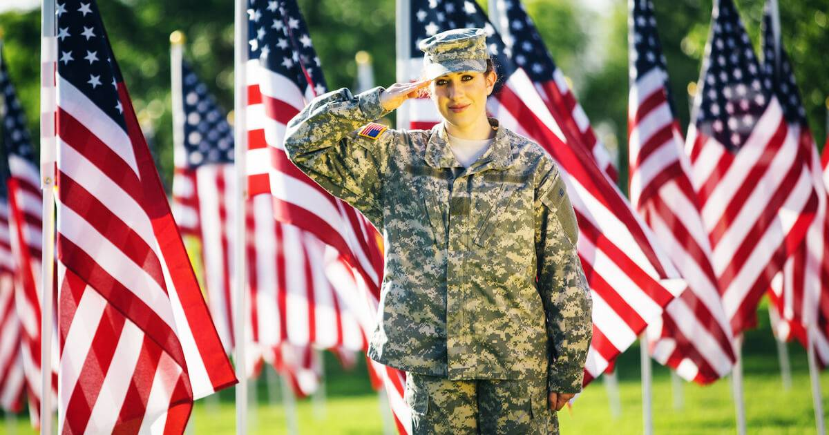 Female veteran saluting American flags. Veterans pbs rewire