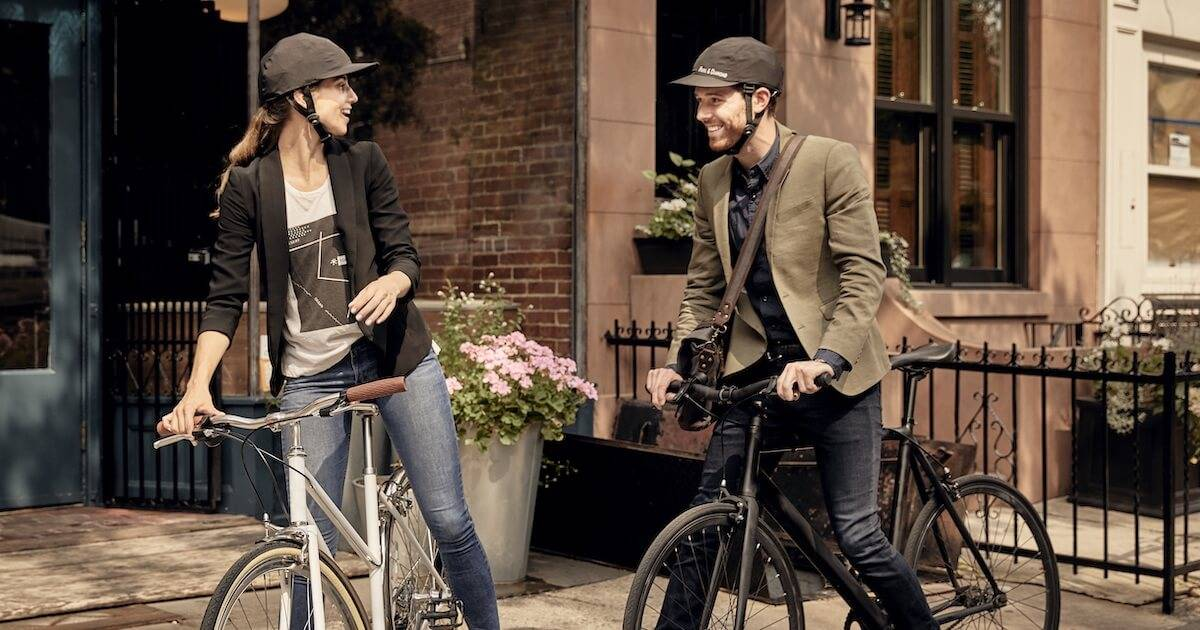 Photo of man and woman wearing Park & Diamond helmet. Better Bike Helmet pbs rewire