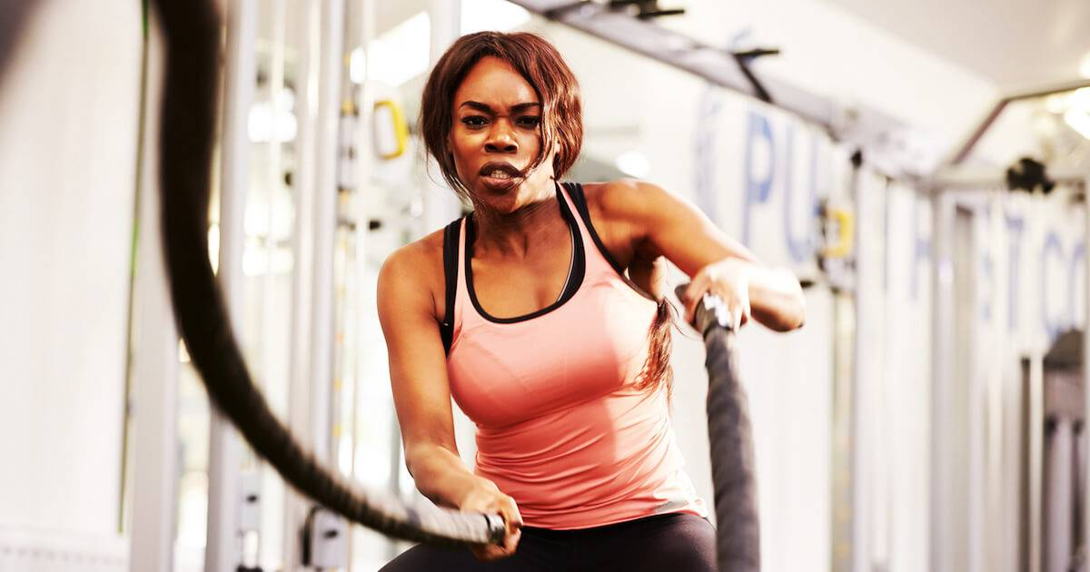Photo of African-American woman working out in a gym with ropes. pbs rewire