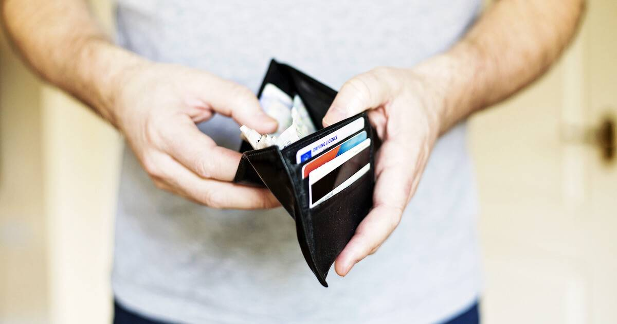 Photo of man opening his wallet to only find a few dollar bills. Start Saving pbs rewire