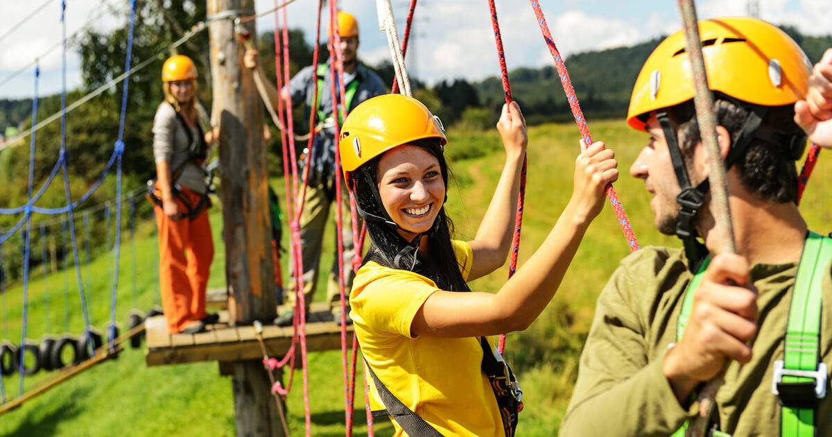 Photo of two couples exploring an adventure climbing park. Financial Peer Pressure pbs rewire