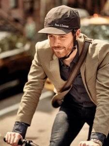 Photo of man riding his bicycle with Park & Diamond helmet. Better Bike Helmet pbs rewire