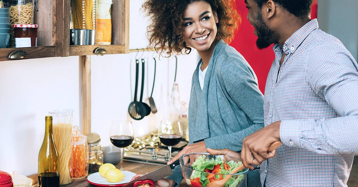 African-american couple in love cooking vegetarian lunch together in kitchen. Food Compatibility pbs rewire