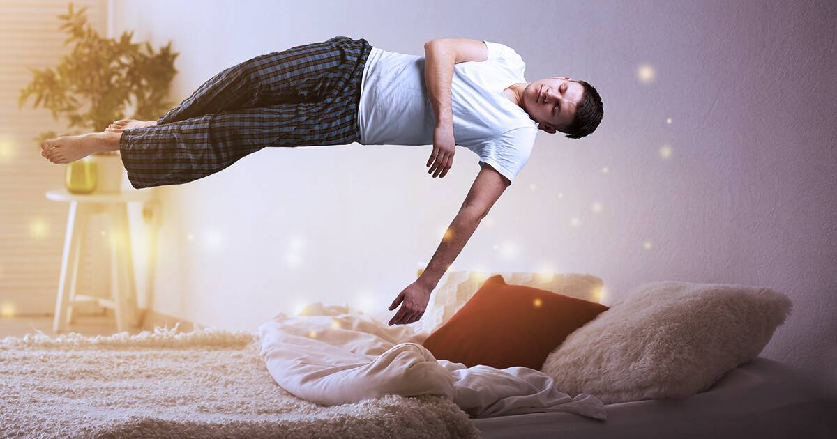 Photo of a young man levitating over bed. Rewire Living PBS More Sleep