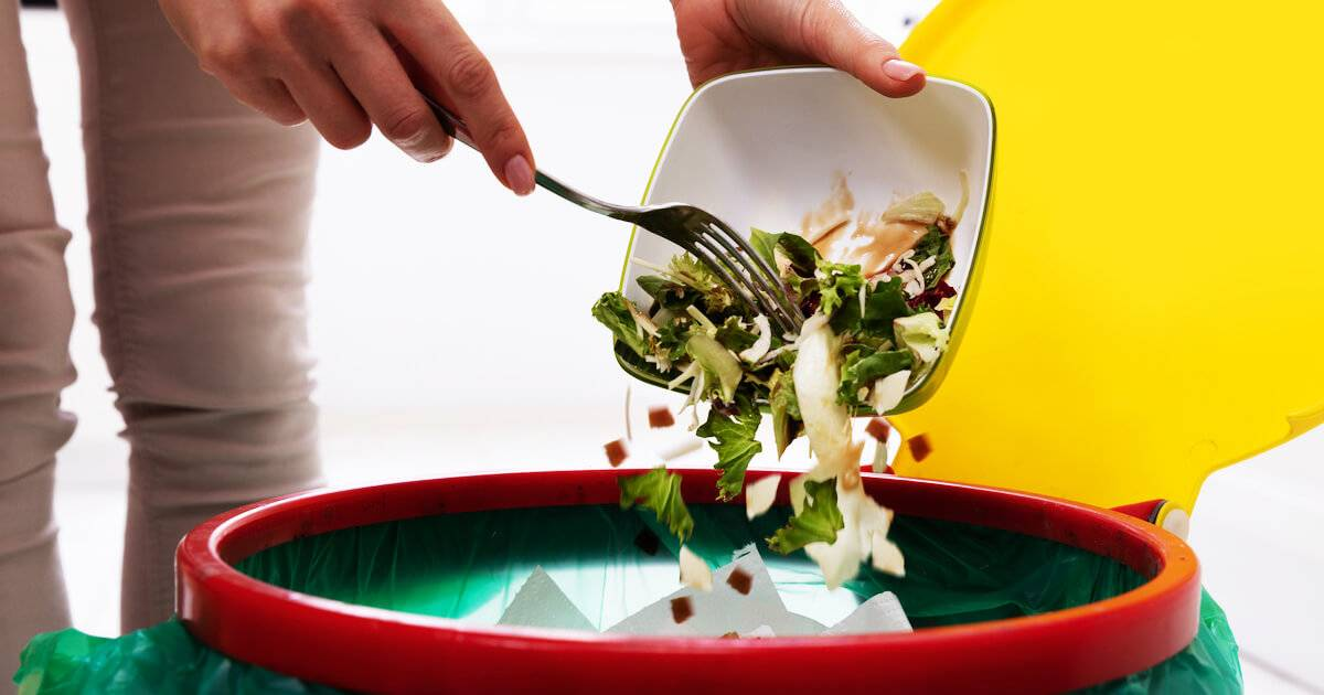 Photo of woman throwing most of a salad in the trash. Stop Wasting Food pbs rewire
